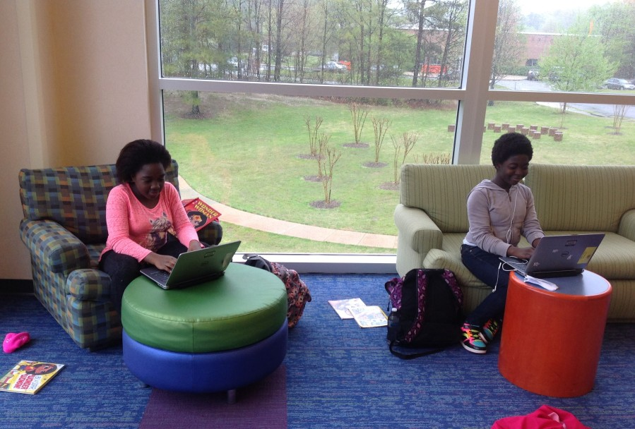 Two young teens studying with laptops in the teen space at Tuckahoe Library
