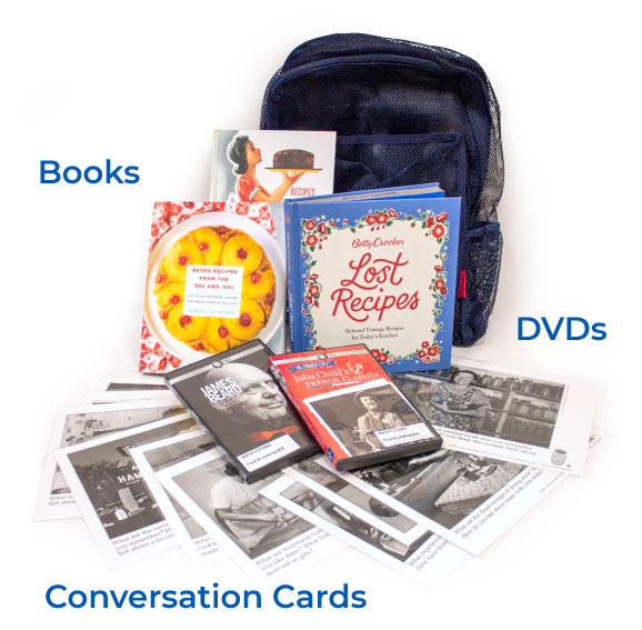 Image of a caregiver kit containing three books about food, two DVD, a variety of conversation cards with historic images and a prompt, and a backpack to contain them.