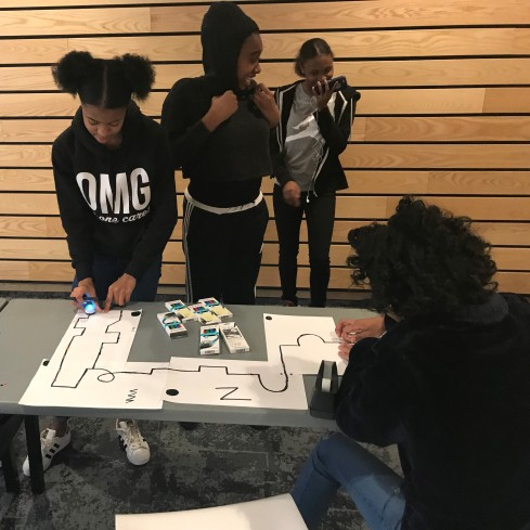Four young women designing a maze for the Ozobot robots,