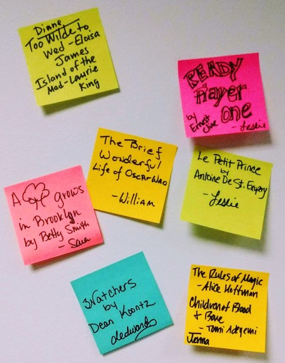 Post it notes containing book titles: Too Wilde to Wed by Eloisa James, Island of the Mad by Laurie King, A Tree Grows in Brooklyn by Betty Smith, Watchers by Dean Koontz, The Brief Wondrous Life of Oscar Wao by Junot Diaz, Ready Player One by Ernest Cline, Le Petit Prince by Antoine De St. Exupery, The Rules of Magic by Alice Hoffman, Children of Blood and Bone by Tomi Adeyemi