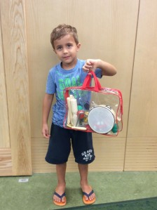Colin holding the YISSVIC Kids Musical Instruments Set