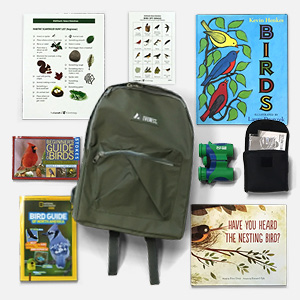 Image of birding kit with backpack, binoculars, guidebooks, and storybooks